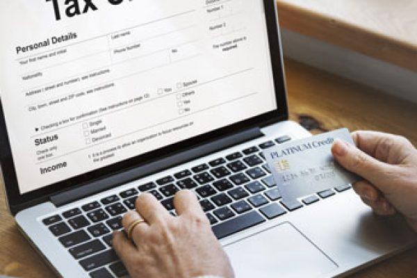 tax-credits-claim-return-deduction-refund-concept-PQR22EP9
